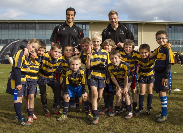 DCRFC U8s meeting Newcastle Falcons players Tane Tu'Ipulotu (left) and Luke Fielden (right) at the Newcastle Falcons festival on Saturday 13 October 2012